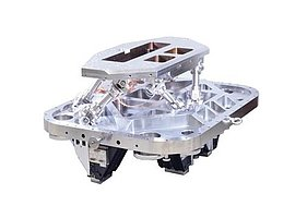 Customized hexapod designed for EUV applications: The drives (in this case electric motors) are mounted outside the EUV chamber; inside there are only passive elements for power transmission.